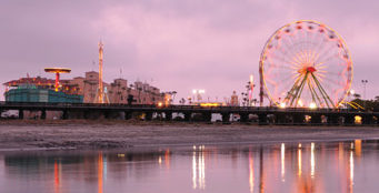 The Ferris wheel and other rides as seen from the lagoon.