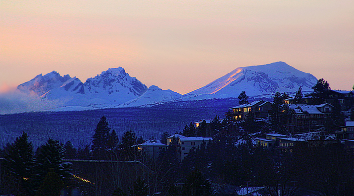 The Three Sisters mountains over Bend, Oregon on a winter evening