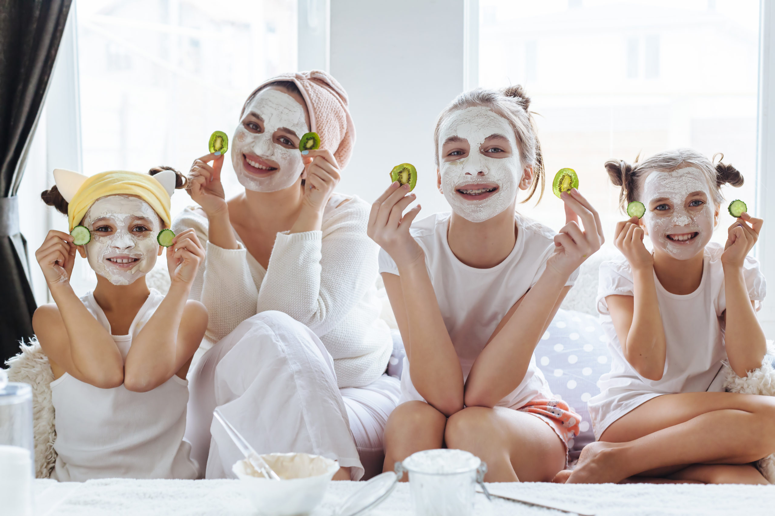 Mom with her daughters making clay face mask